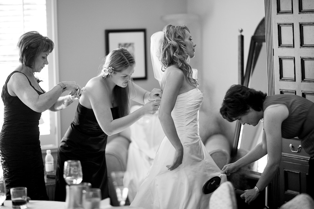 Bride gets help getting ready
